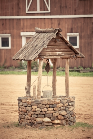 ancient wishing well of old western building Standard-Bild