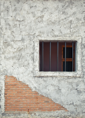 Prison window on the stone brick wall Stock Photo - 16849379