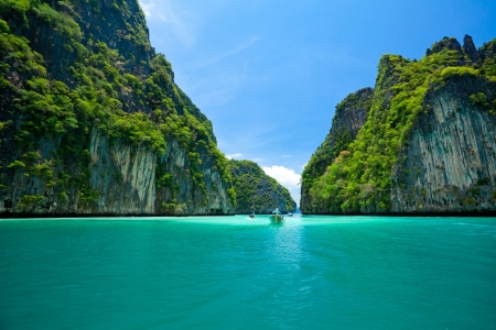paradise bay: boat moving in sea Phi Phi Leh south of Thailand Stock Photo