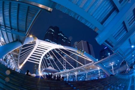 Crowd Walking at Skywalk and Night traffic lights in the Bangkok, Thailand photo