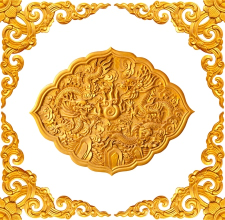 golden frame and dragon carve isolated on white background photo
