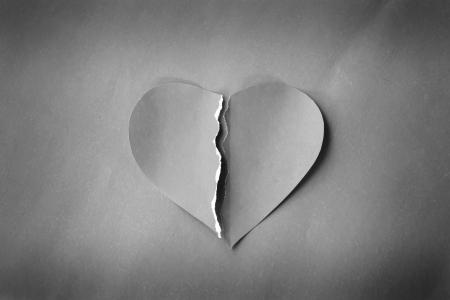 grunge heartbroken on paper background photo