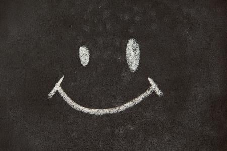 smile face: Face cartoon Chalk on blackboard background
