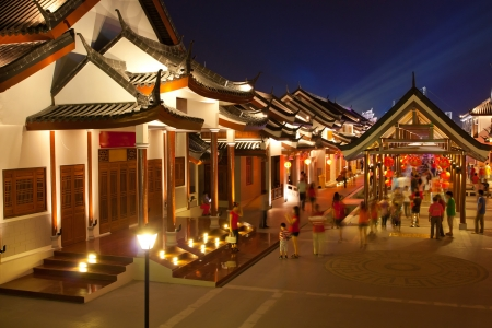 chinatown: crowd walking in chinese ancient town at night Editorial