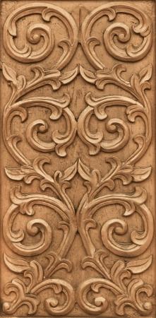 ウッドの背景に刻まれた花のパターン