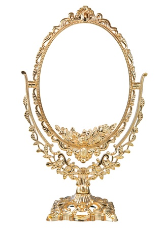 Antique baroque brass gold frame and mirror isolated on white background photo