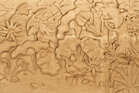 Pattern of nature carved on wood in Bali, Indonesia photo