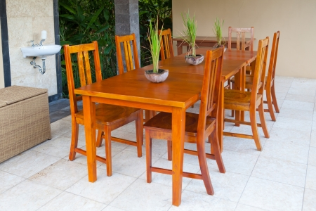 bar area: Wooden table and chairs in tropical style