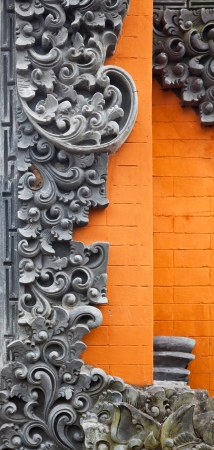 stone carving: Bali brick wall with stone carving