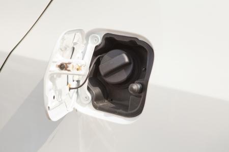 refuel: Closeup refuel gasoline on white car