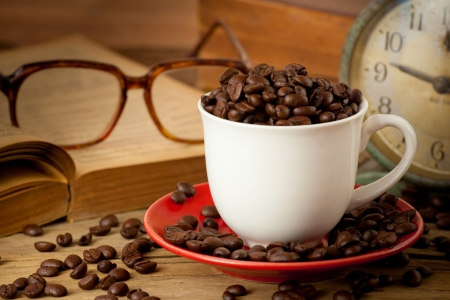 coffee cup and coffee beans on dark background photo