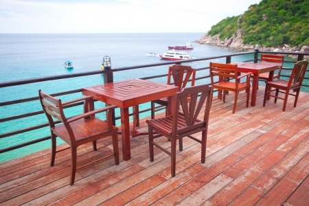 Chairs, table on the balcony of the restaurant near the sea photo