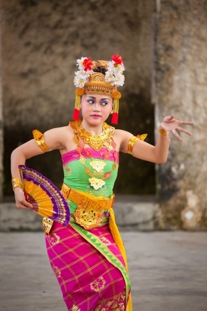BALI, INDONESIA -  MARCH 16: Balinese girls perform Legong and Barong Dance in Bali, Indonesia on March 16, 2013. Its a famous dance with intricate finger movements and complicated footwork.