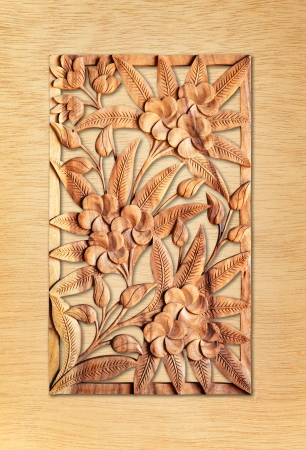 Pattern of flower carved isolated on wood background photo