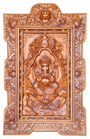 Hindu God Ganesh carving wood on white background photo