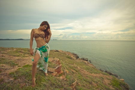 sexy asian woman: Portrait of sexy young asian woman with hat on mountain and sea