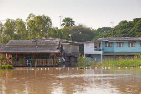 overtake: flood waters overtake house in Thailand Stock Photo