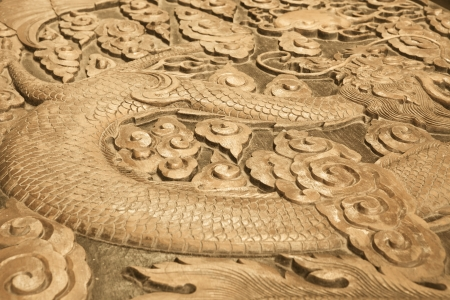 Close up of wood carving of a dragon photo