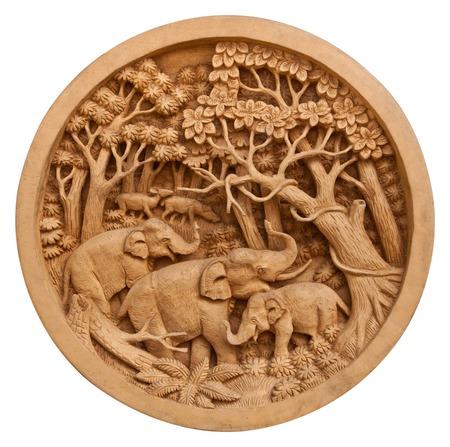 サークル木製フレーム上のタイの象の彫刻 写真素材