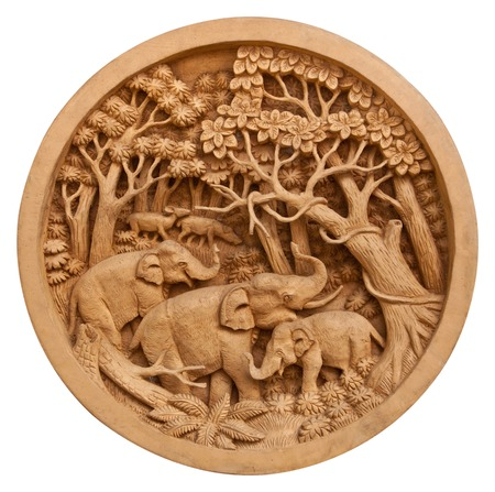 Carved Thai elephant on the circle wood frame photo