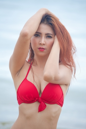 Young beautiful asian woman posing at beach photo