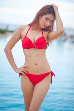 sexy asian girl: Sexy asian girl in red bikini near swimming pool