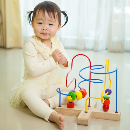 asian family home: Portrait of little asian girl in home Stock Photo