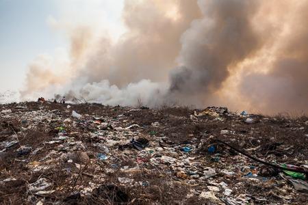 garbage dump: Burning garbage heap of smoke from a burning pile of garbage Stock Photo