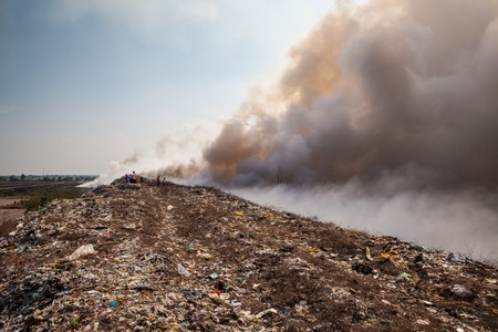 Burning garbage heap of smoke from a burning pile of garbage photo