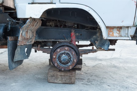 Truck wheel being changed on the side of a road photo