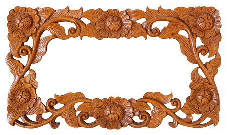 wood carvings: Pattern of flower carved frame isolated on white background