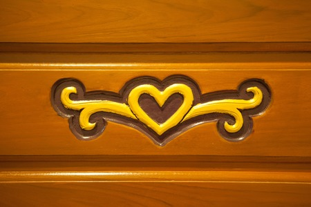 bark carving: Heart shape  on old wooden background