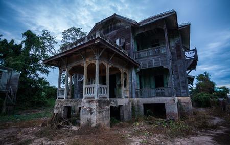 abandoned old house on twilight photo