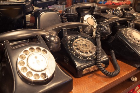 antique phone: old-fashioned classic vintage telephones on the table Stock Photo