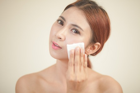 cleanser: A close up of a beautiful young woman removing her make up. Stock Photo