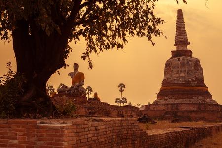 stone buddha: Thai temple sunset, the historical temple in Ayutthaya, Thailand Stock Photo