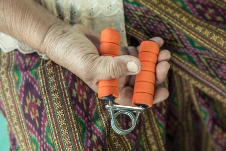 hand grip: Senior asian woman exercise sport hand grip equipment