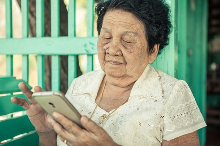 Senior asian woman  with smart phone photo