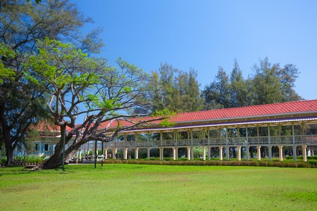 Pavilion and corridor on green grass with blue sky photo