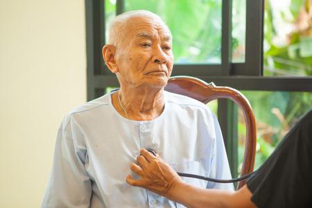friendly doctor caring senior man indoor