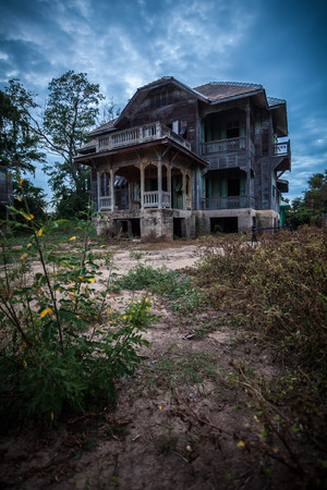 spooky house: abandoned old house on twilight