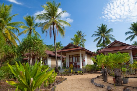 traditional village on the sea with blue sky in Thailand photo