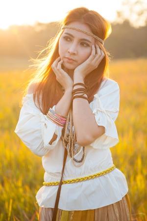 hippie woman: Hippie woman posing in golden field on sunset