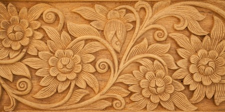 Pattern of flower carved on wood background Reklamní fotografie - 40080768