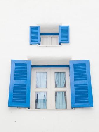 open windows: Santorini Greek style blue closed open windows Stock Photo