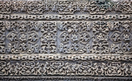 stone carvings: Old stone carvings on the wall temple in Myanmar