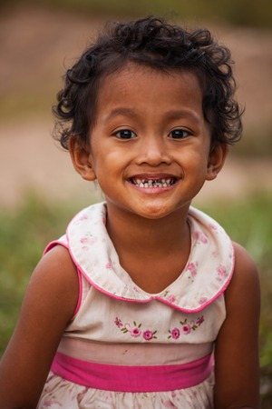 sad little girl: Portrait of smile asian poor girl in Thailand Stock Photo