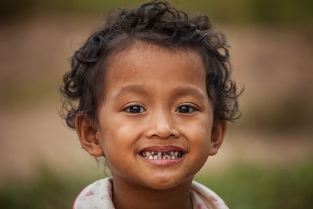 orphan: Portrait of smile asian poor girl in Thailand Stock Photo