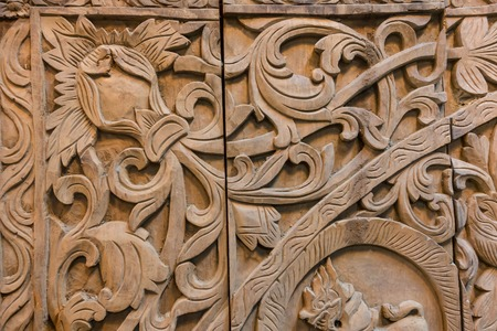 carvings: Pattern of flower carved on wood background