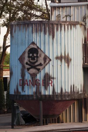 hazardous waste: Toxic waste symbol on a blue barrel Stock Photo